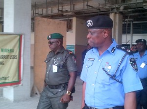 Mr. Kola Sodipo, New Commissioner of Police, Cross River State Command on arrival. Pictured walking out of the arrival lounge of the Margaret Ekpo Int'l Airport, Calabar earlier today @ 12:05pm