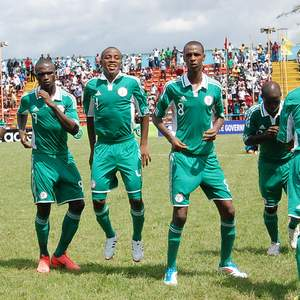 Nigeria's Golden Eaglets celebrating one of their goals against their Botswana counterparts in Calabar