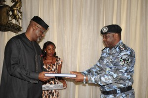 Cross River State Governor,, Senator Liyel Imoke, presenting a sourvenir to the newly posted Assistant Inspector General (AIG) of Police Zone 6, Calabar, AIG Jonathan Johnson when the service commanders paid the governor a courtesy visit today.