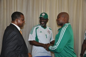 Cross River State Governor, Senator Liyel Imoke (m) flanked by the 1st Vice President NFF, Chief Mike Umeh ( R) and Chief Coach, Super Eagles,Stephen Keshi(R),shortly after the team presented the 2013 AFCON trophy they won in South Africa to the governor today.