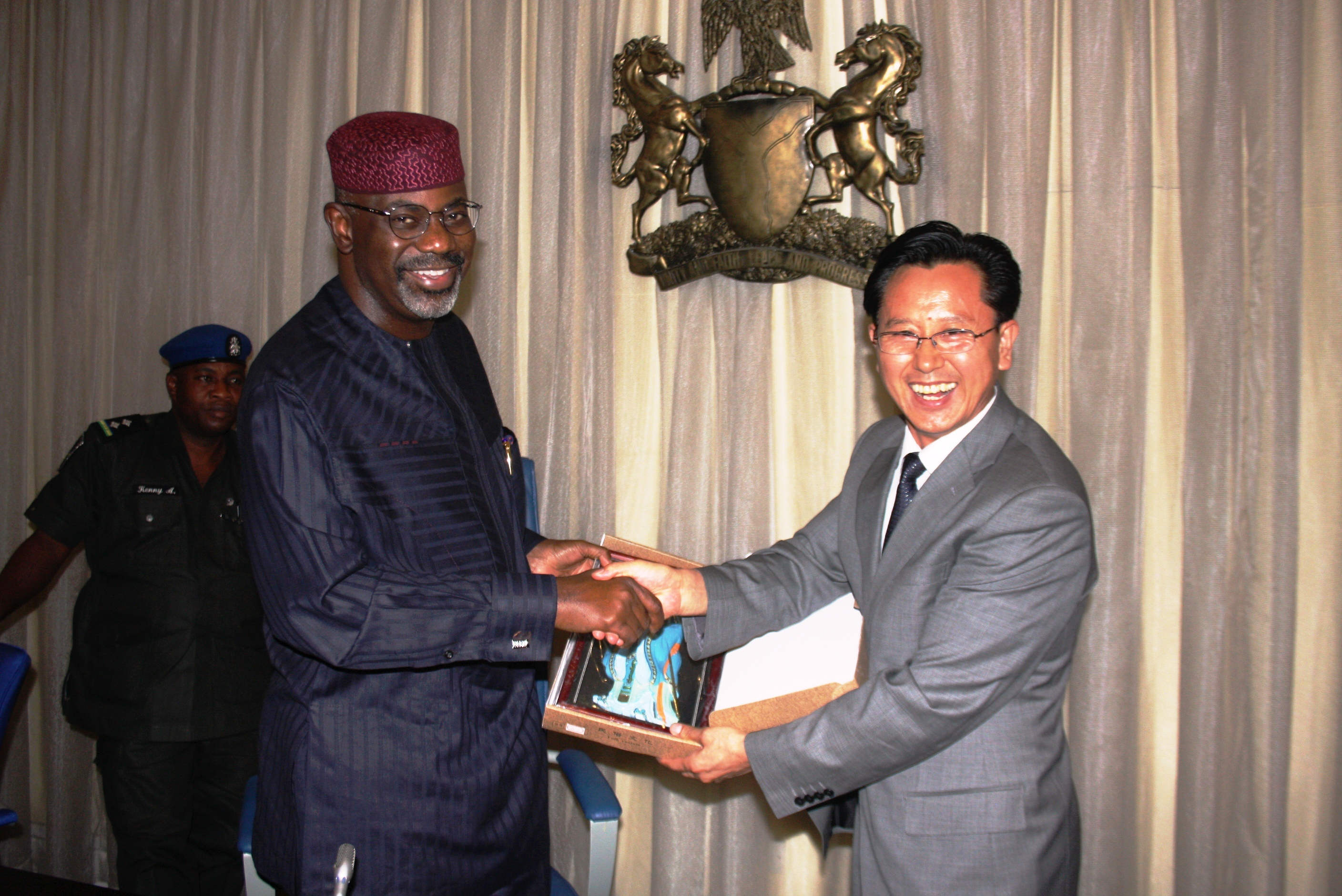 Cross River State Governor, Senator Liyel Imoke(L) receiving a letter of invitation to China from Deputy Mayor of Chang Chun Province,China, Mr. Gui Guangli when the latter led a delegation on Trade Mission to Government House Calabar, yesterday, Friday