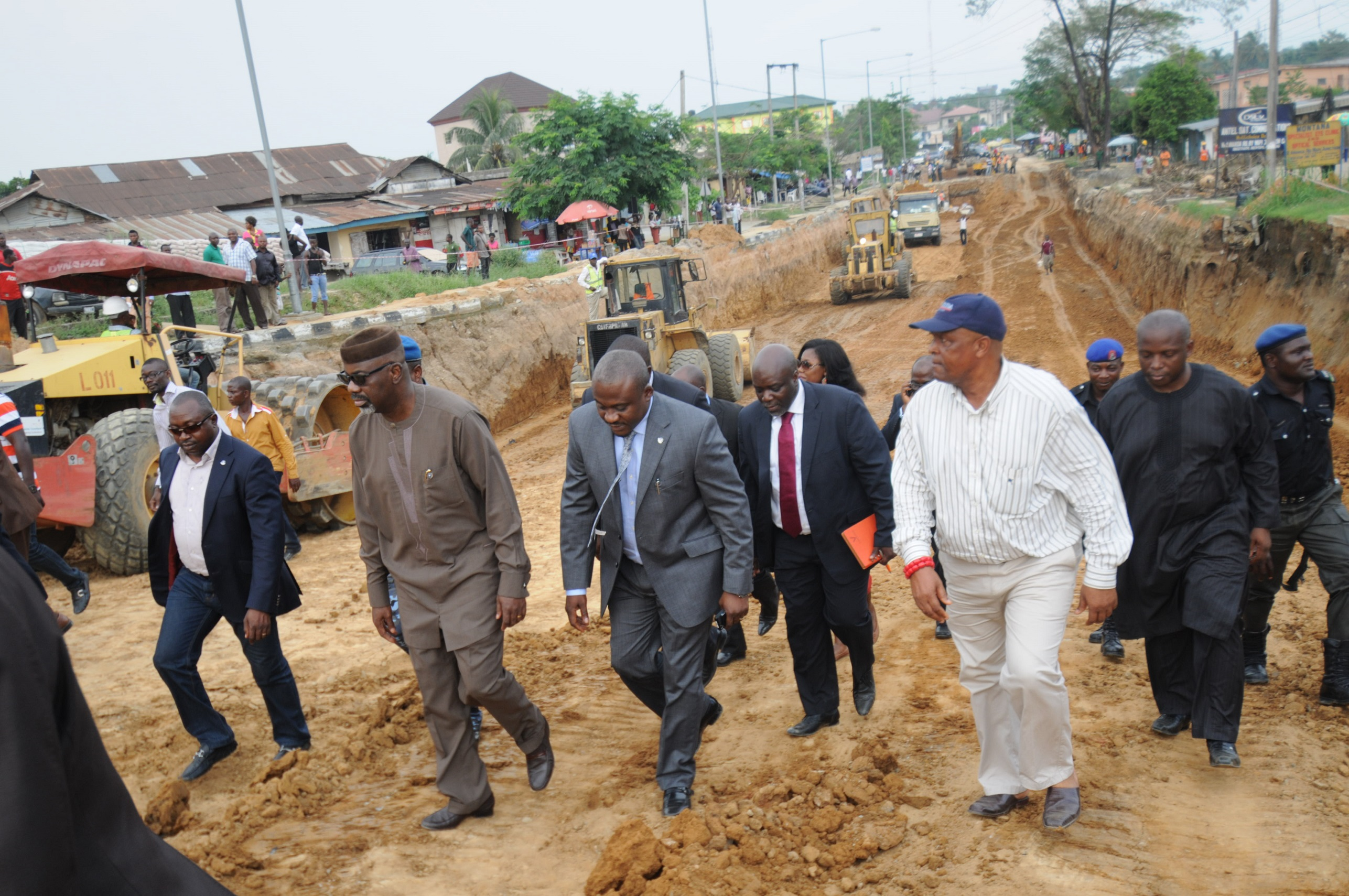 Governor Imoke and his Works Commissioner (in front) while inspecting the Channel 2 drain in Calabar