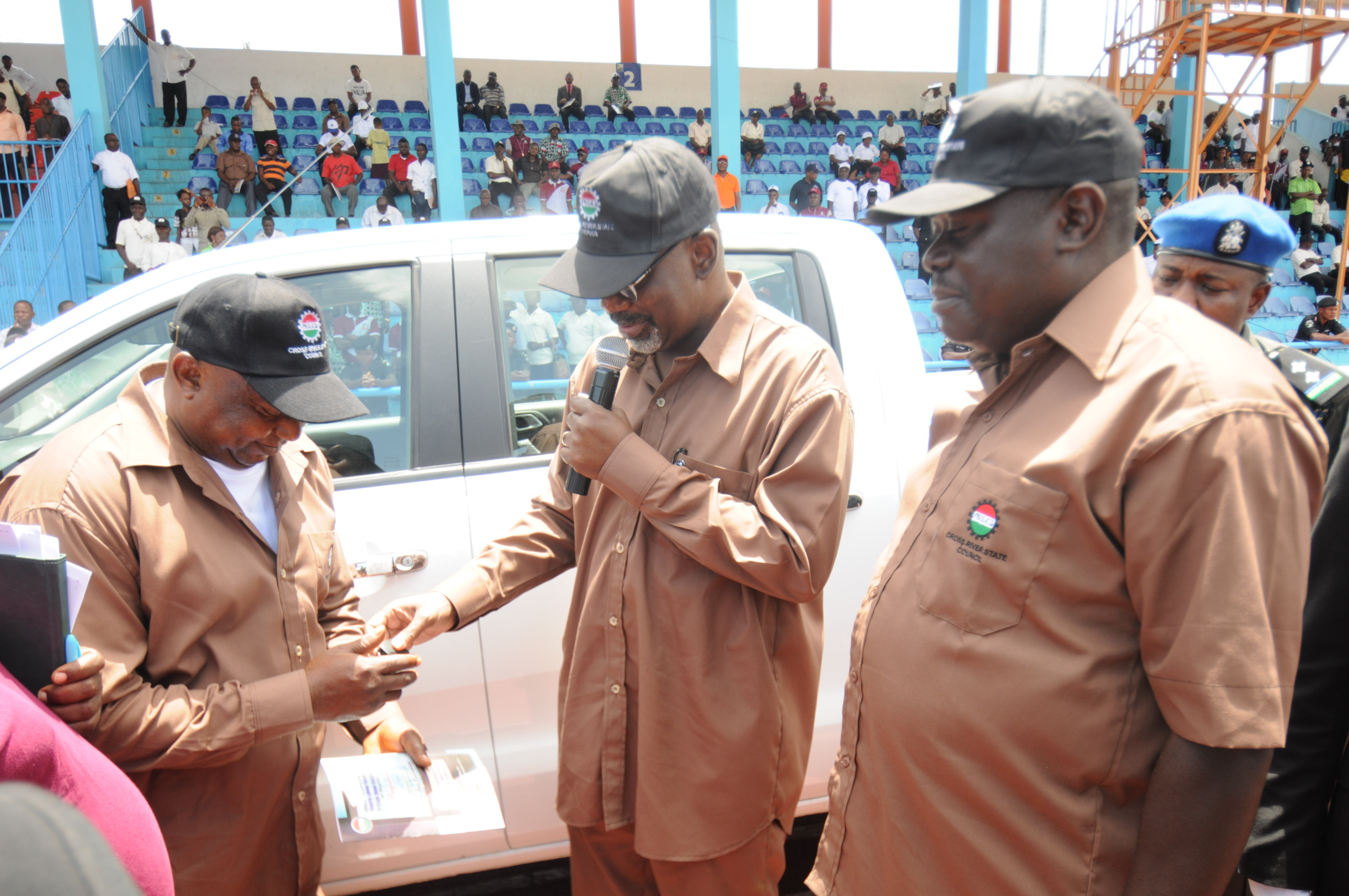 Cross River State Governor, Senator Liyel Imoke(M) presenting a Pick up van keys to the State Chairman, NLC, Comrade Nyambi Ojom while the Deputy Governor, Mr. Efiok Cobham watches when the governor presented vehicles to trade unions to mark the 2013 May Day in Calabar today