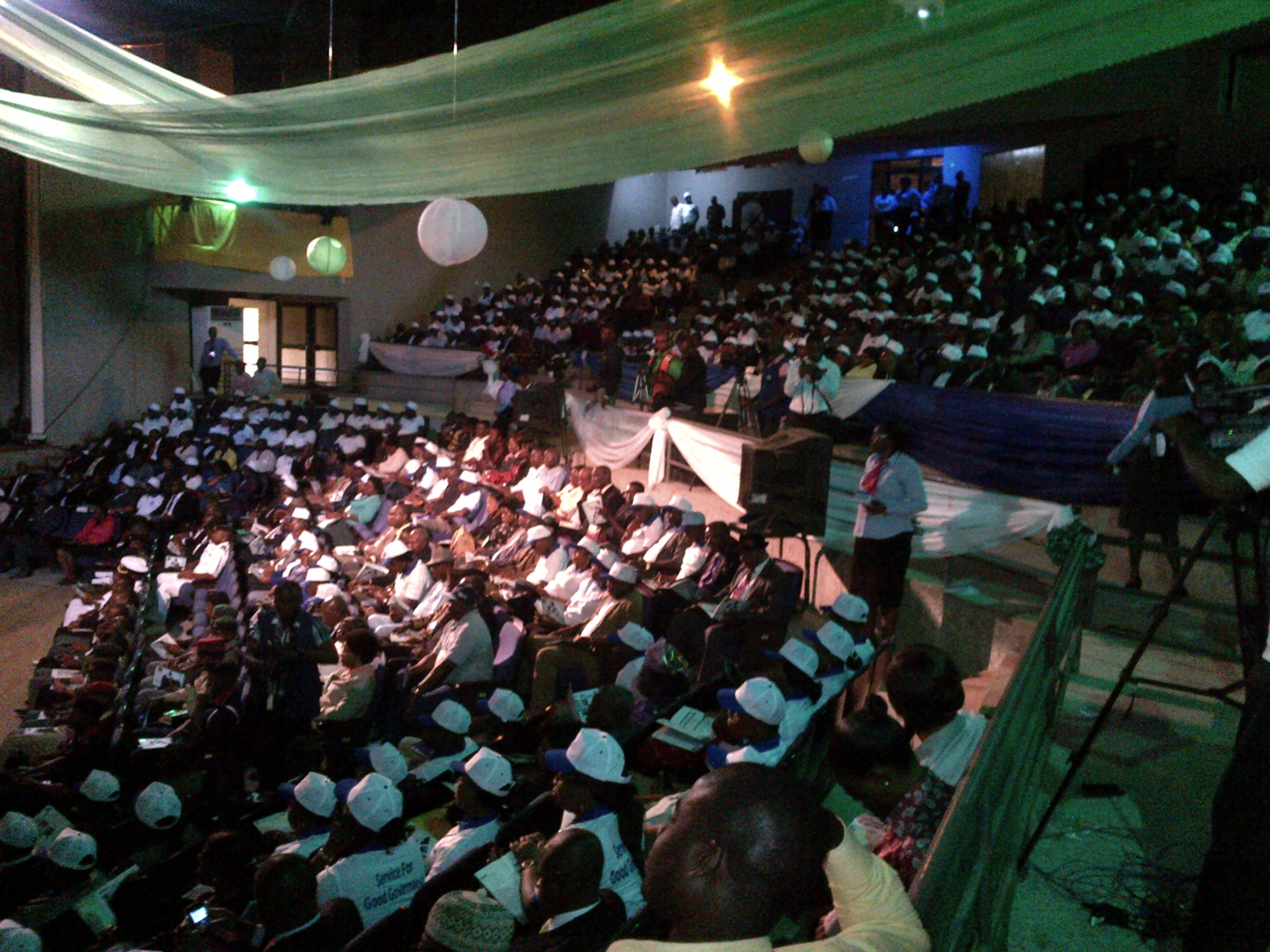 A cross section of civil servants listening to Governor Imoke at the Cultural Center on the Civil Service Day celebration.