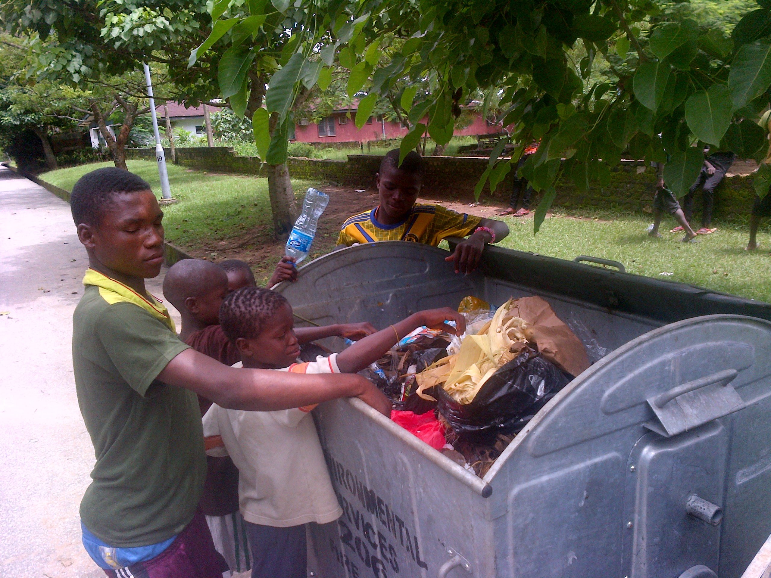 Street children picking food from a dustbin in Calabar