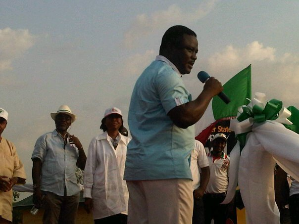 Senator Ben Ayade with the microphone on stage