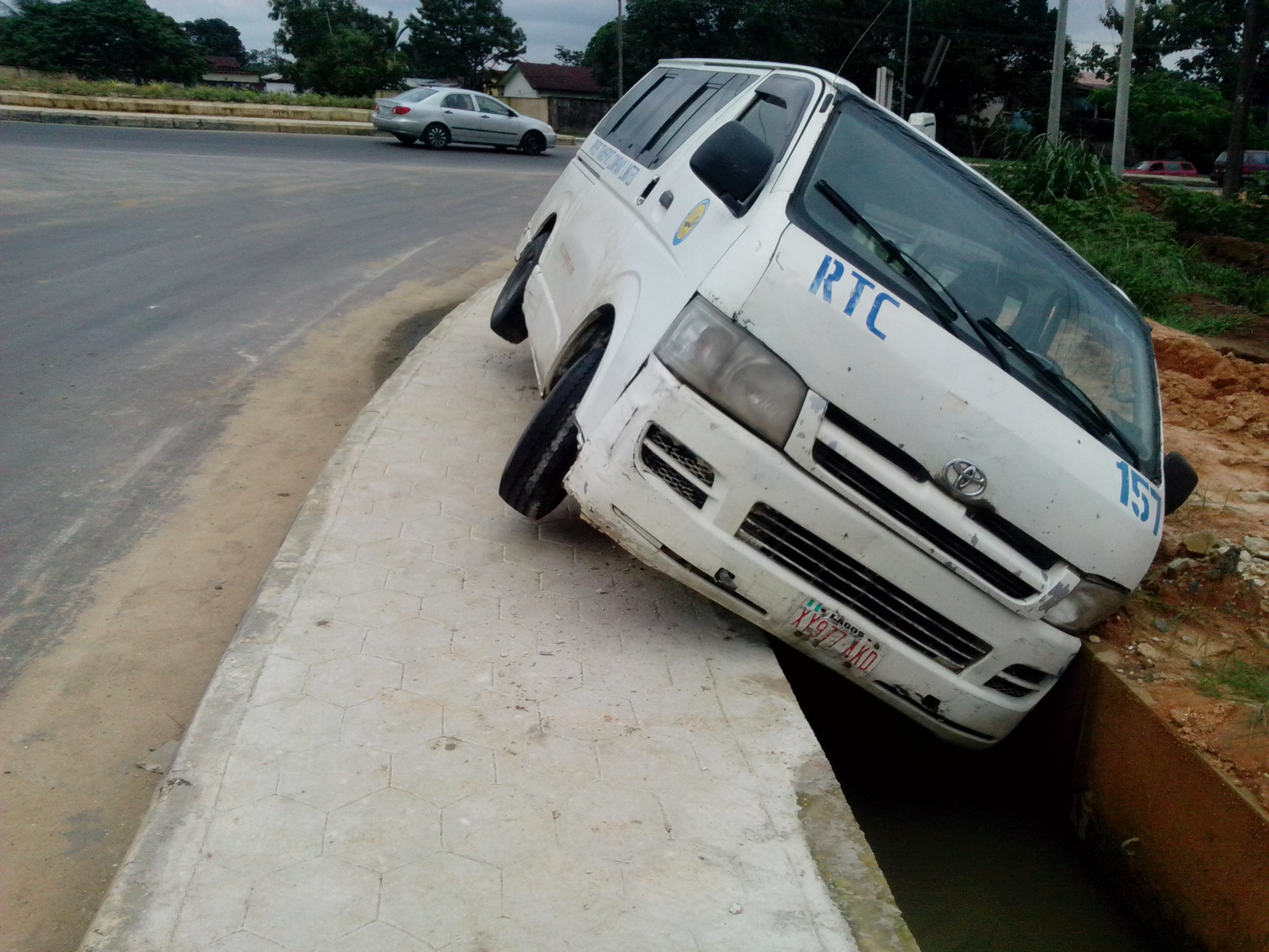 A crashed Rivers Transport Company vehicle at the roundabout