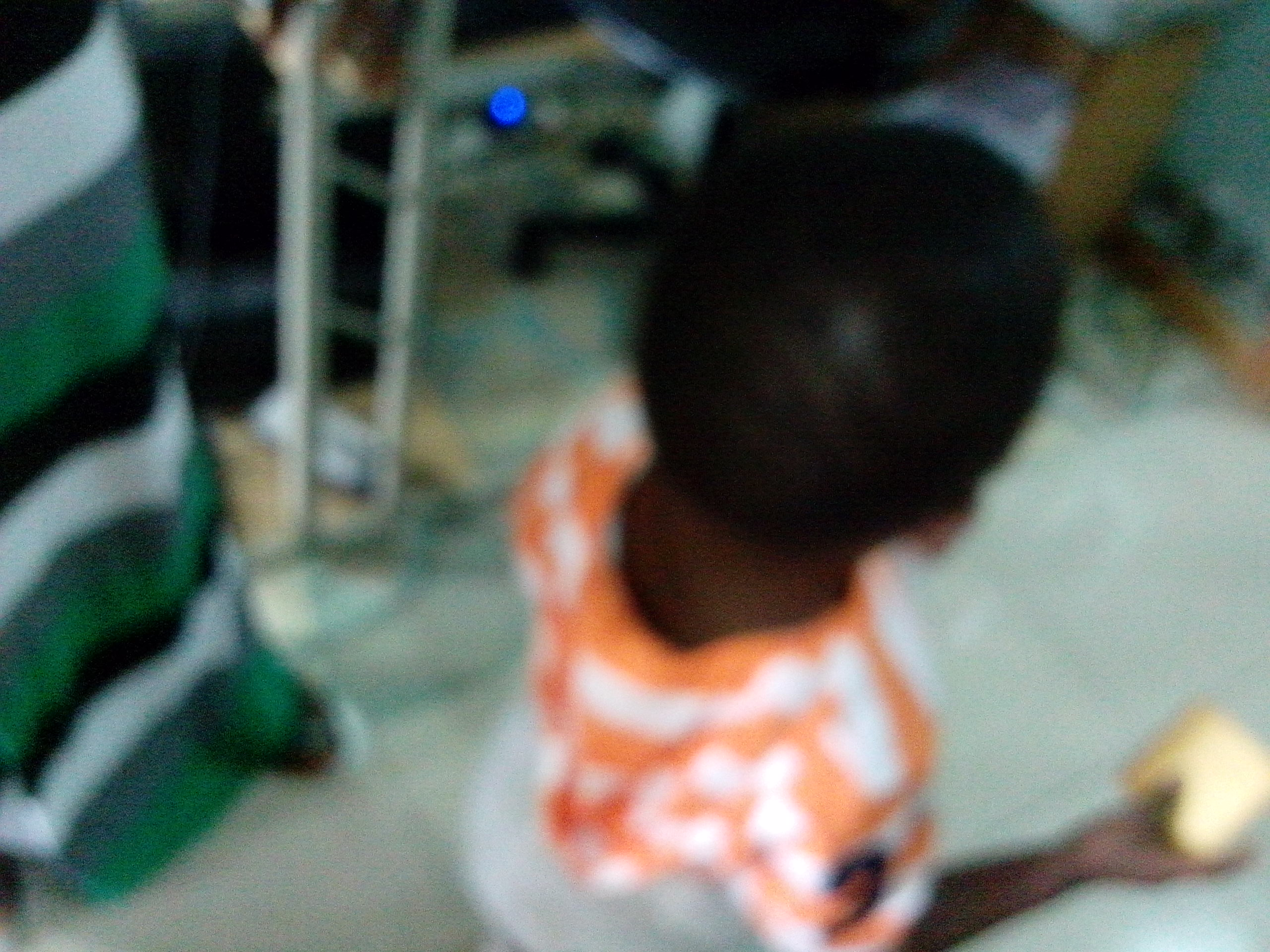 Blurred picture of the defiled toddler