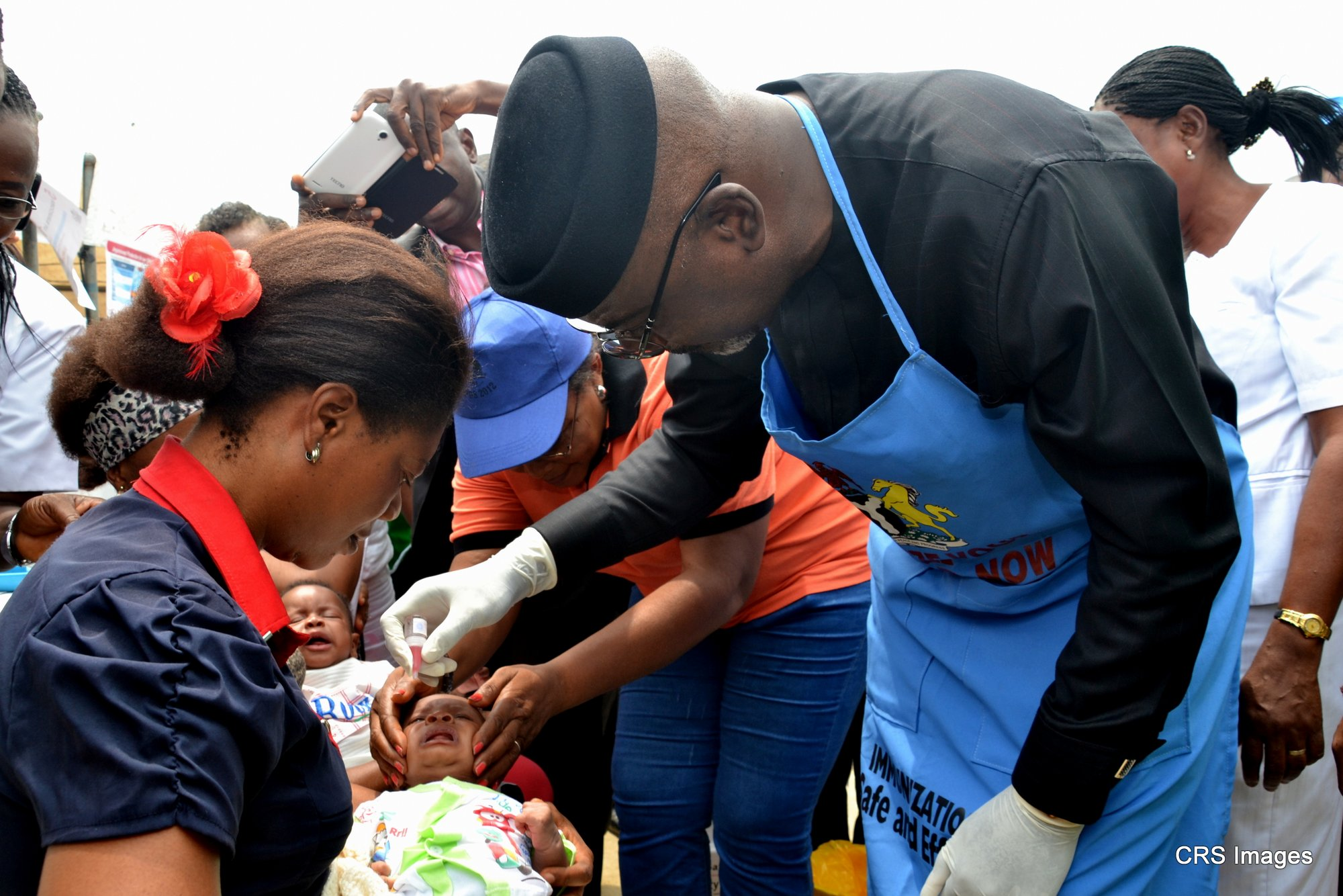 Governor Imoke administering vaccine to a child during the immunization exercise in Calabar