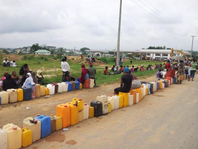 Waiting for Kerosene:Long queues at a petrol station in Calabar