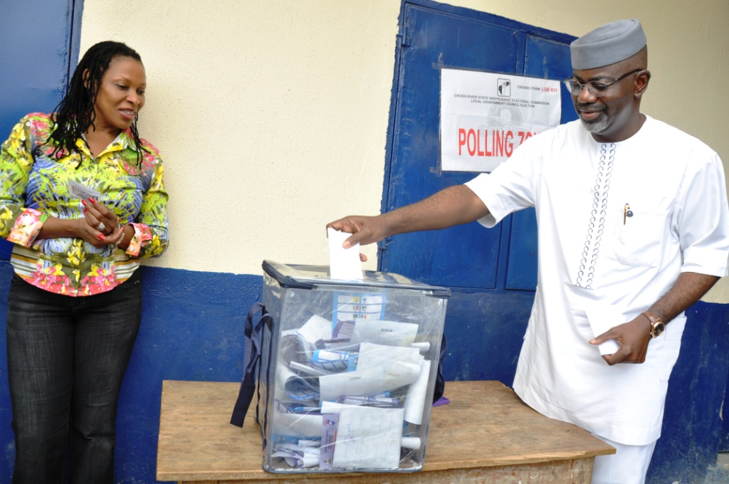 Cross River State Governor, Senator Liyel Imoke casting his vote at Government Primary School Itigidi polling booth in Abi LGA during the local government election while the wife Mrs. Obioma Liyel Imoke watched after casting hers