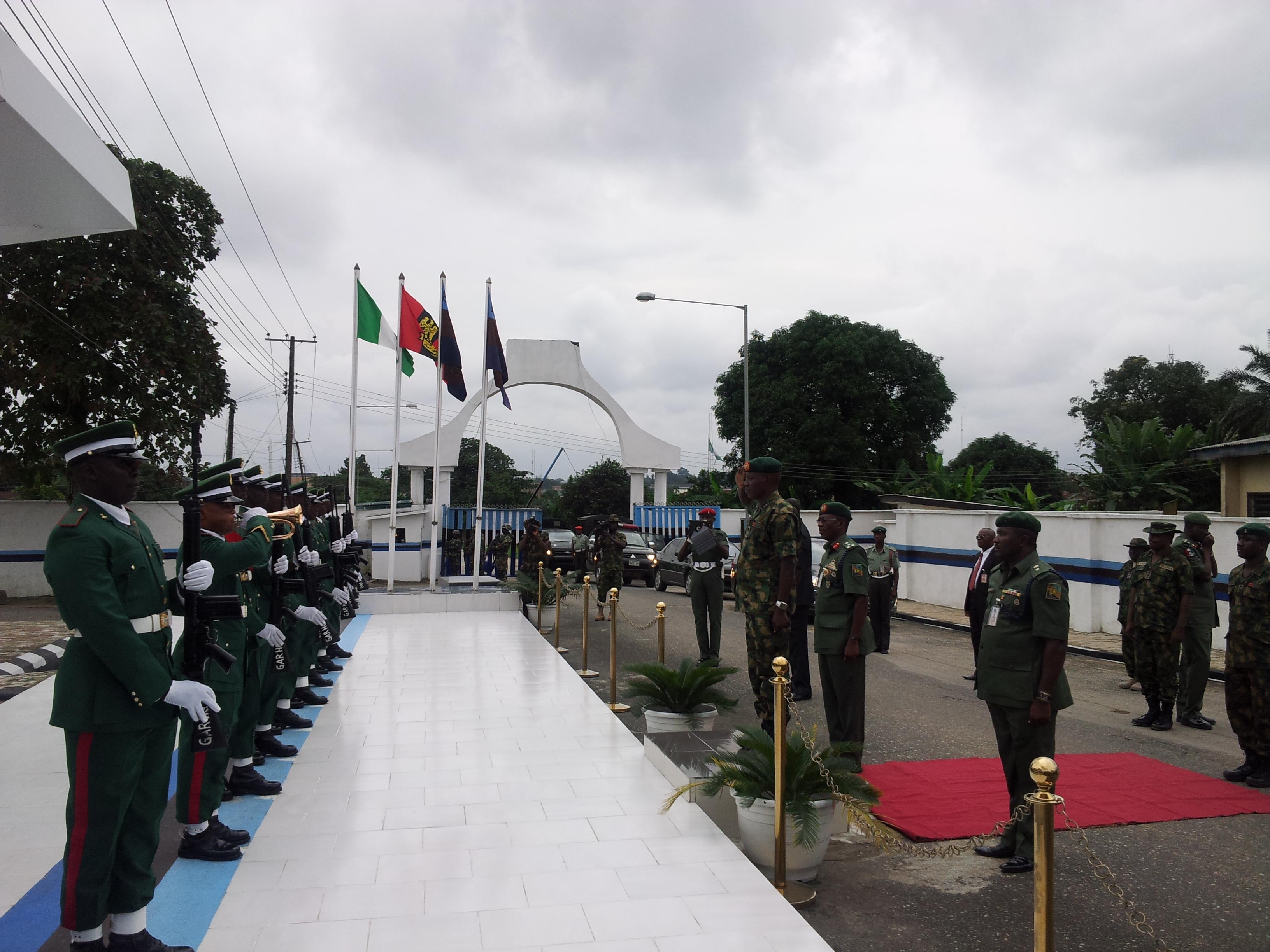 General Officer Commanding, 82 Division, Major General Ashimiu Adebayo inspecting the guard of honor at the 13 brigade barracks, Calabar