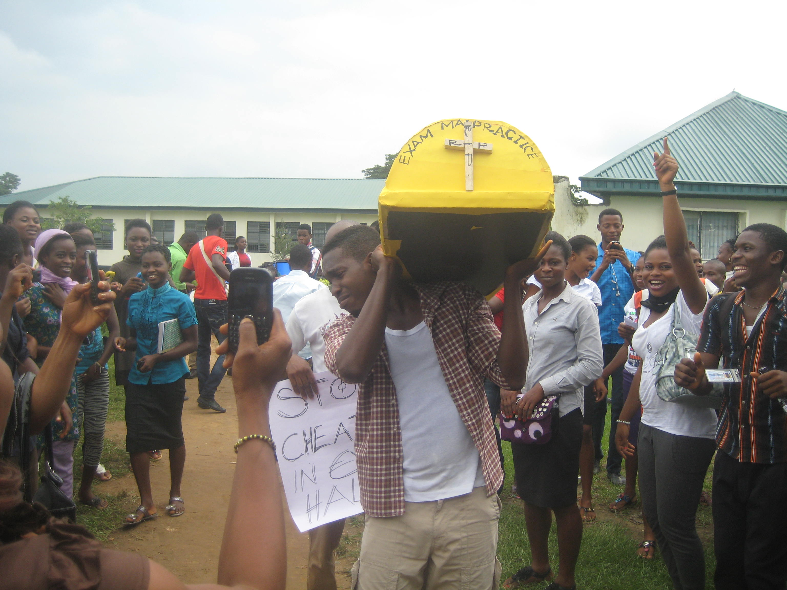 Students of the college on the burial procession for exam malpractice