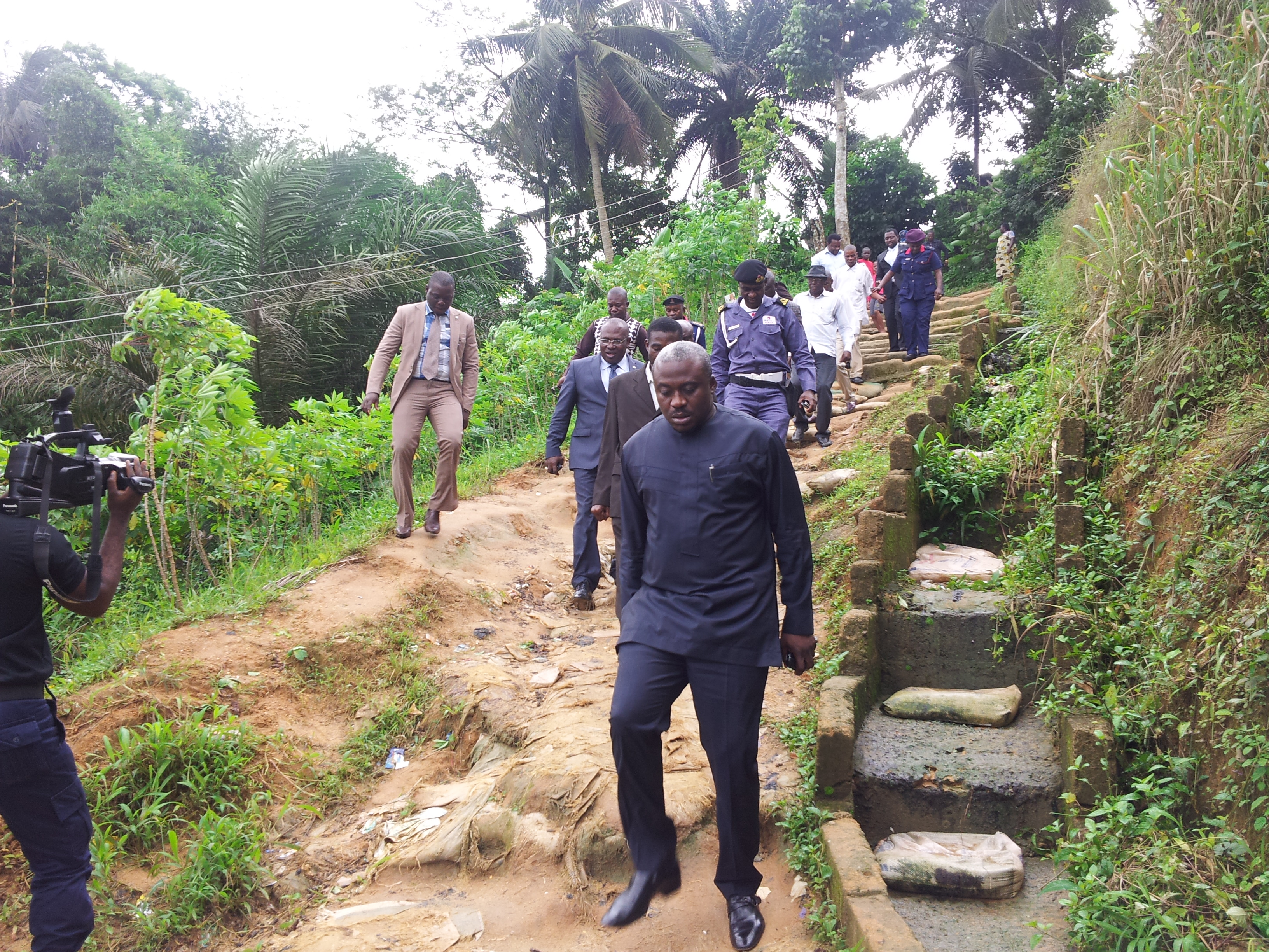 Legor Idagbo leading the team of government officials to the erosion disaster site today
