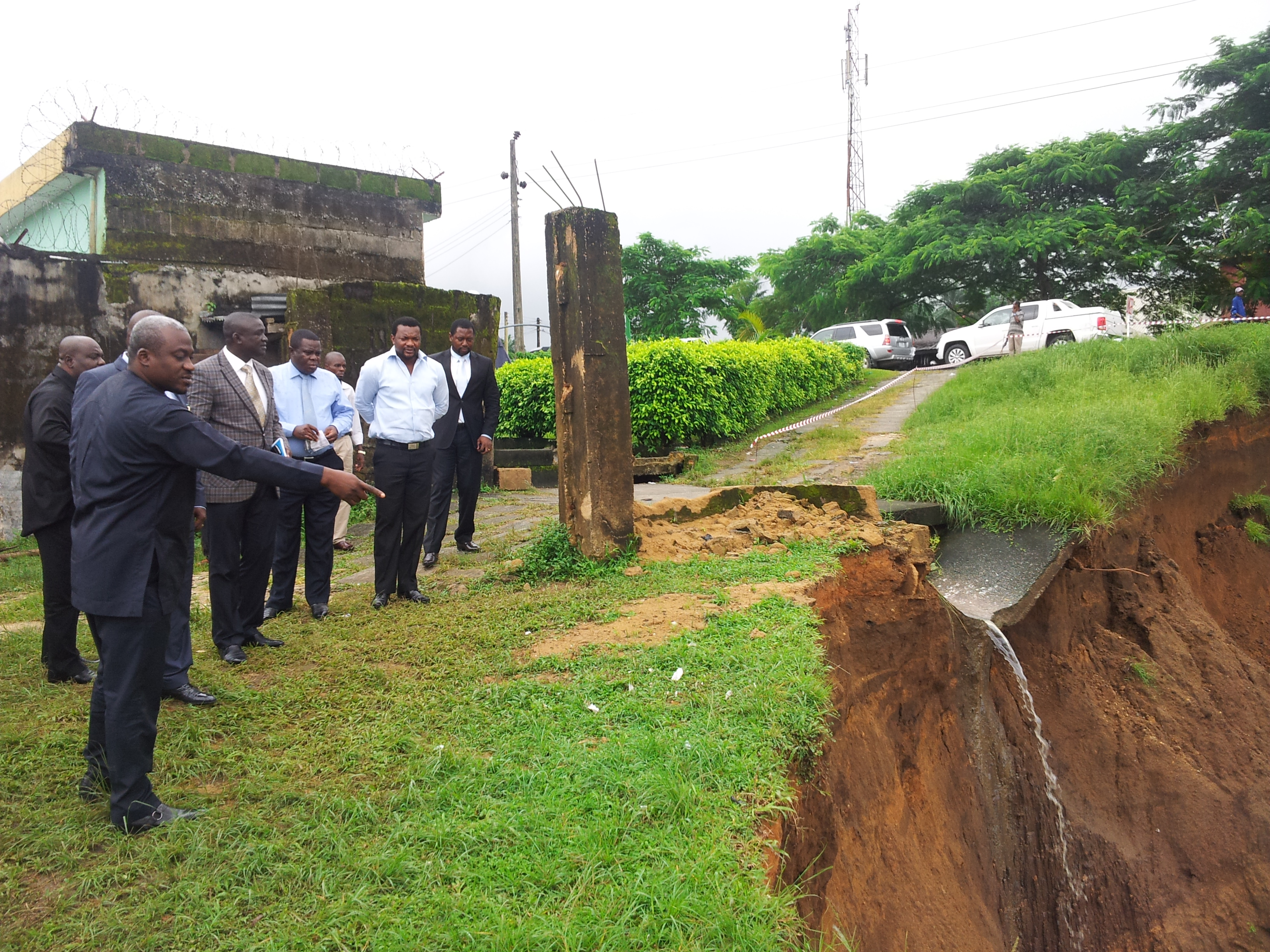 Commissioner for Works, Legor Idagbo and his Environment counterpart inspecting the erosion site earlier this morning