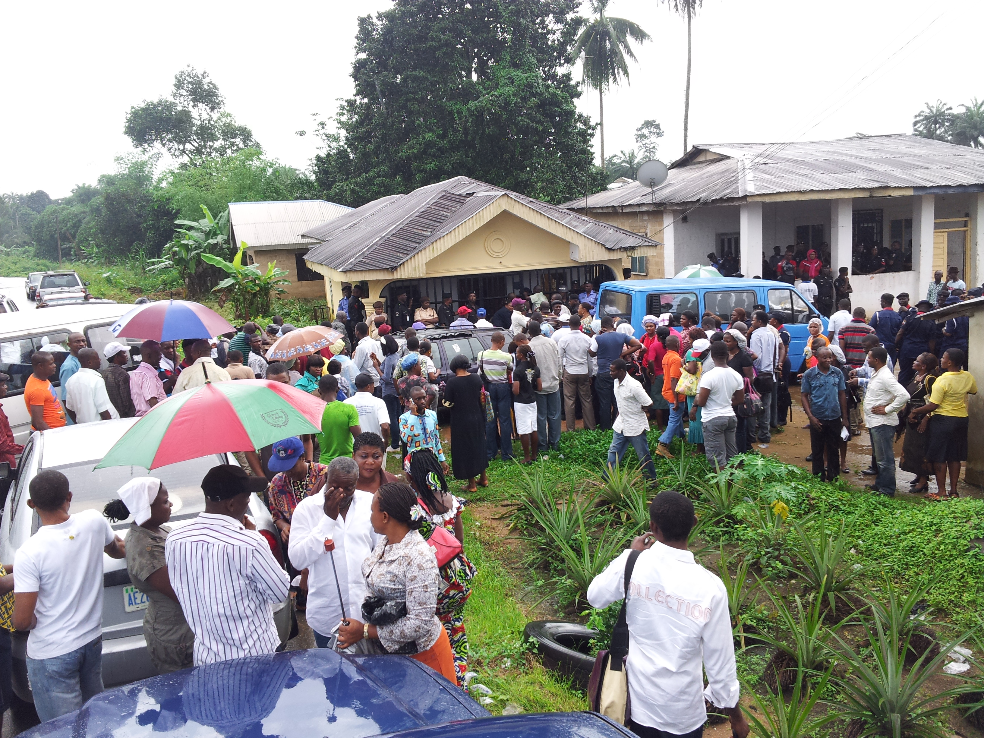 Voters in Obutong, Bakassi LGA under the rains waiting for materials