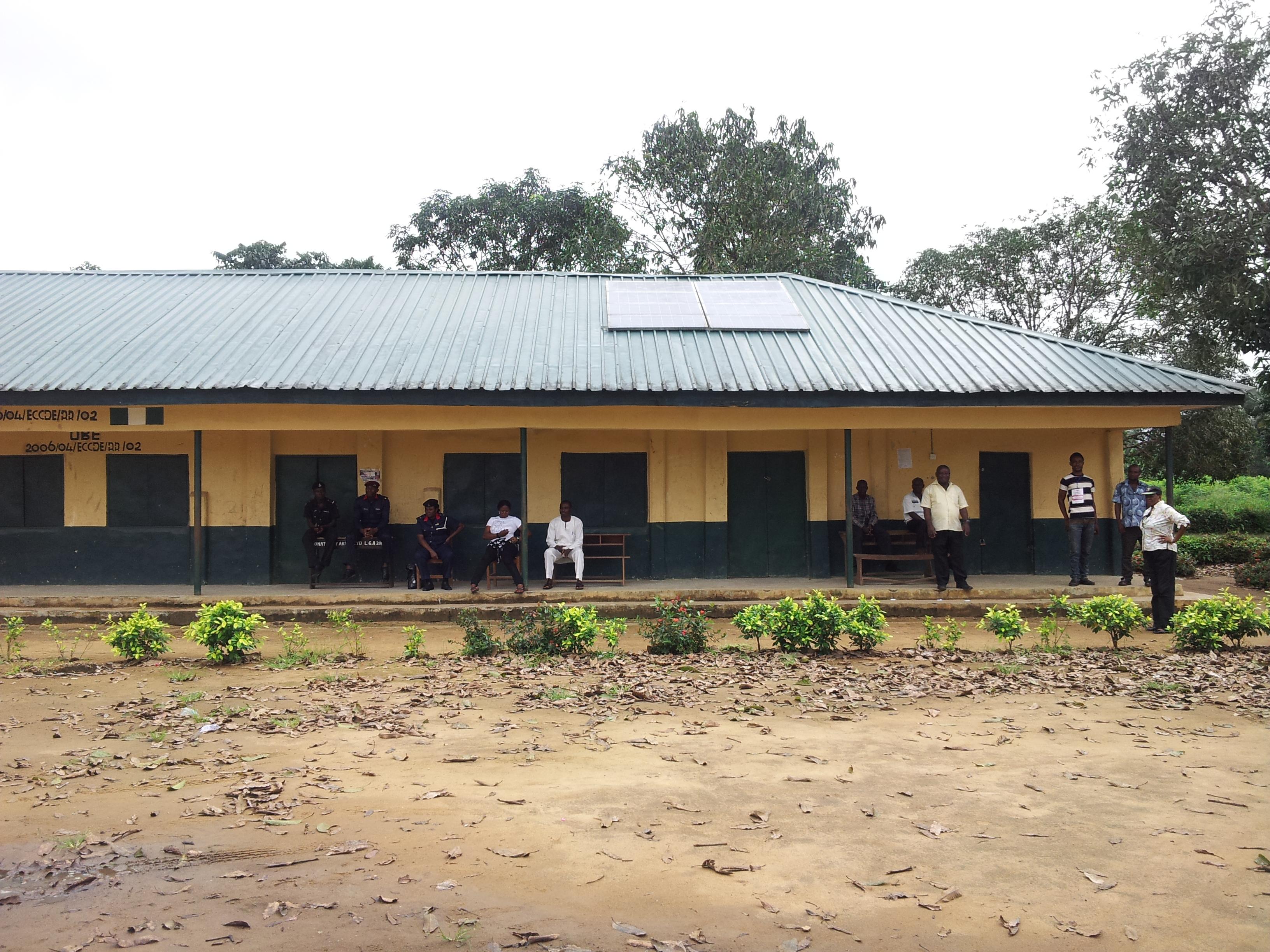 Security men and voters waiting for materials at Presbyterian Primary School, Ikot Nakanda, Akpabuyo