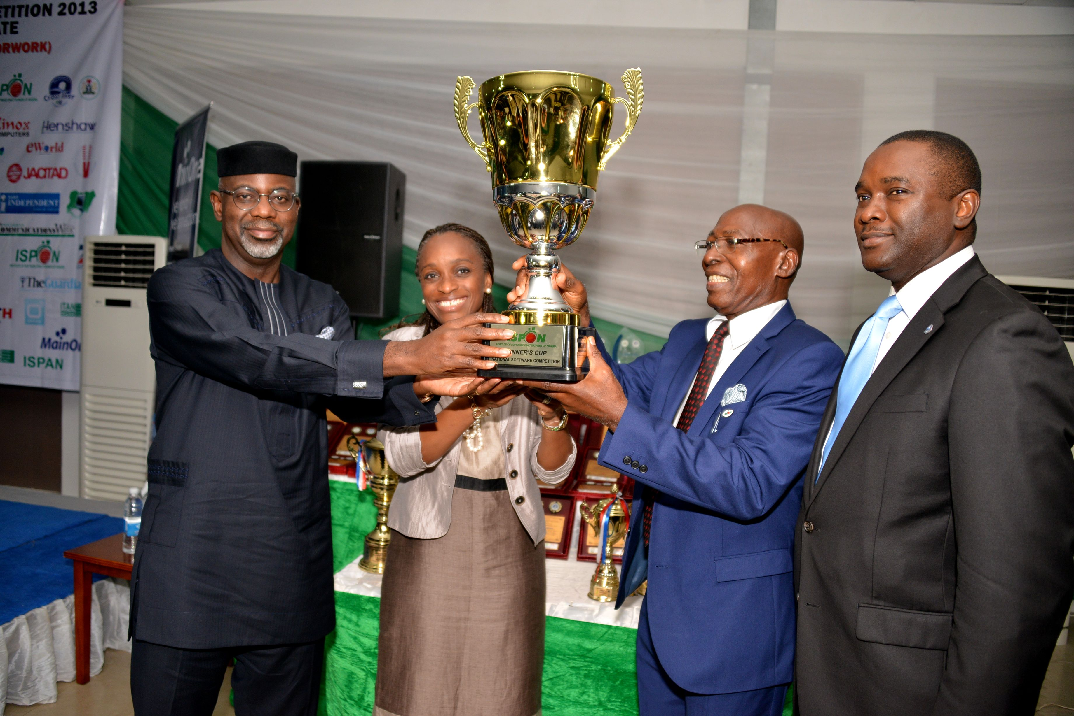 Cross River River Governor, Senator Liyel Imoke receiving a trophy as the ICT Governor of the Year from the President/Chairman of Council, ISPON, Mr. Chris Uwaje(2nd left),assisted by the Honorable minister for ICT, Mrs. Omobola Johnson while Mr. Odo Effiong SA to Imoke on ICT devt watched during the 2013 Institute's National Software Conference & Competition at Tinapa, Calabar