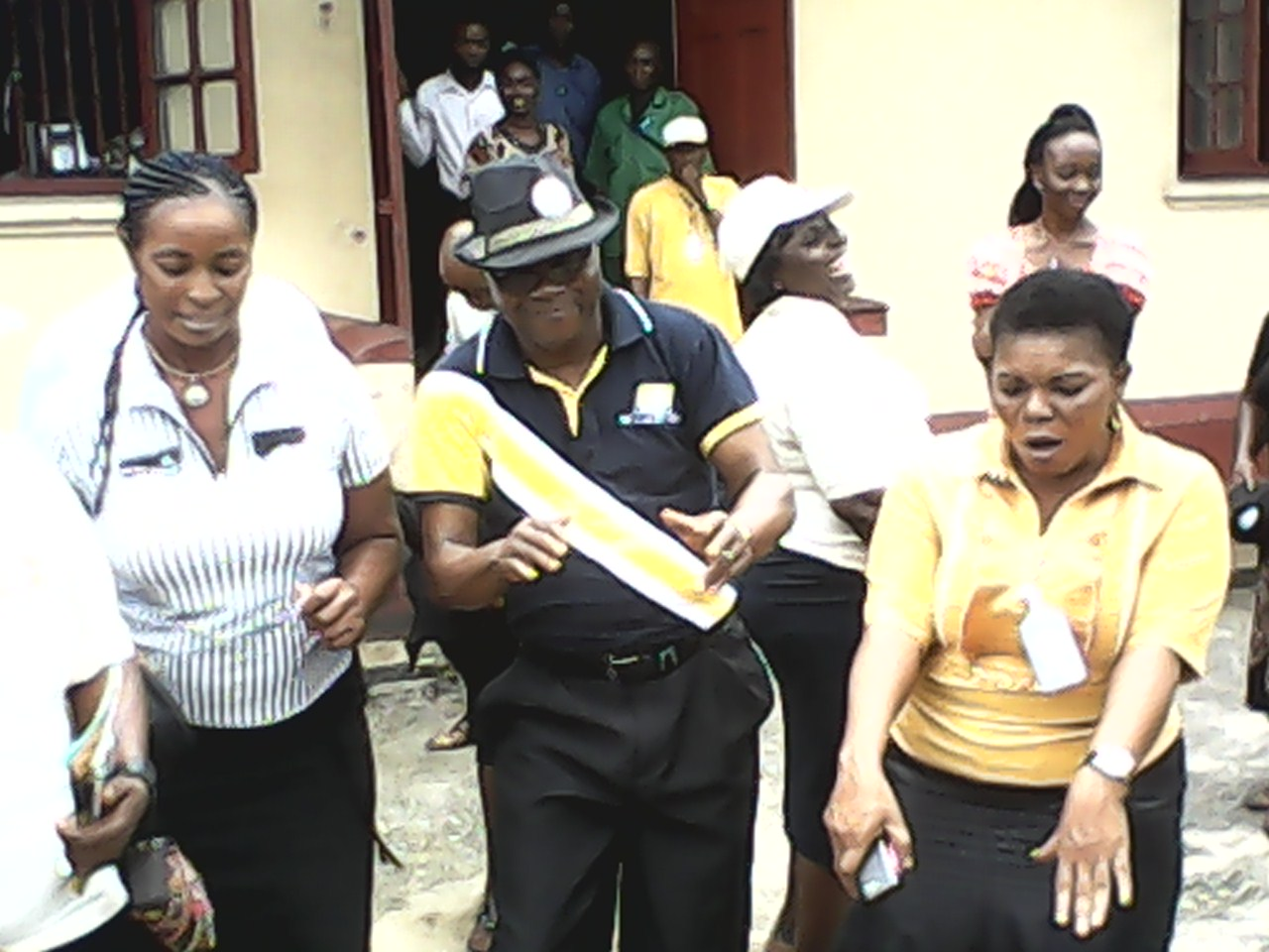 NIPOST Cross River regional manager celebrating with staff