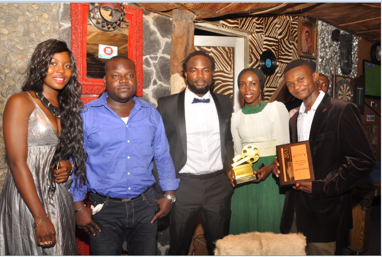 African Film Critics Award (NAFCA) aka Black Oscar, Best Actor in diaspora of the year award winner, Igoni Archibong (middle) with friends at the surprise party to honor him in Calabar on Monday