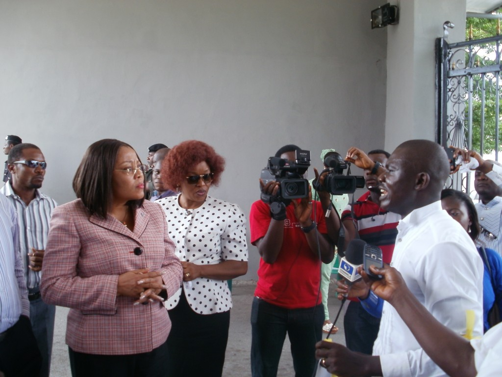 Bar. James Ibor, Executive Director, Basic Rights Counsel addressing the Press during an earlier protest to the ministry while the Commissioner, Bar. Patricia Endeley watches on