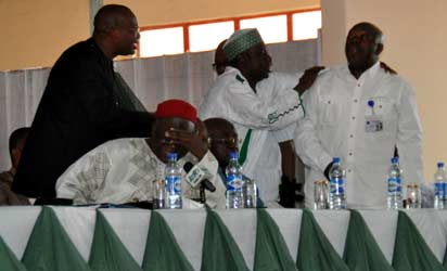 Dr. Sani Indabawa, Secretary, Presidential Advisory Committee on National Dialogue restrains Col Tony Inyiam (rtd), member of the Committee, who shouted  at Governor Adams Oshiomhole of Edo State after making his presentation to the Committee in Benin City, on Monday