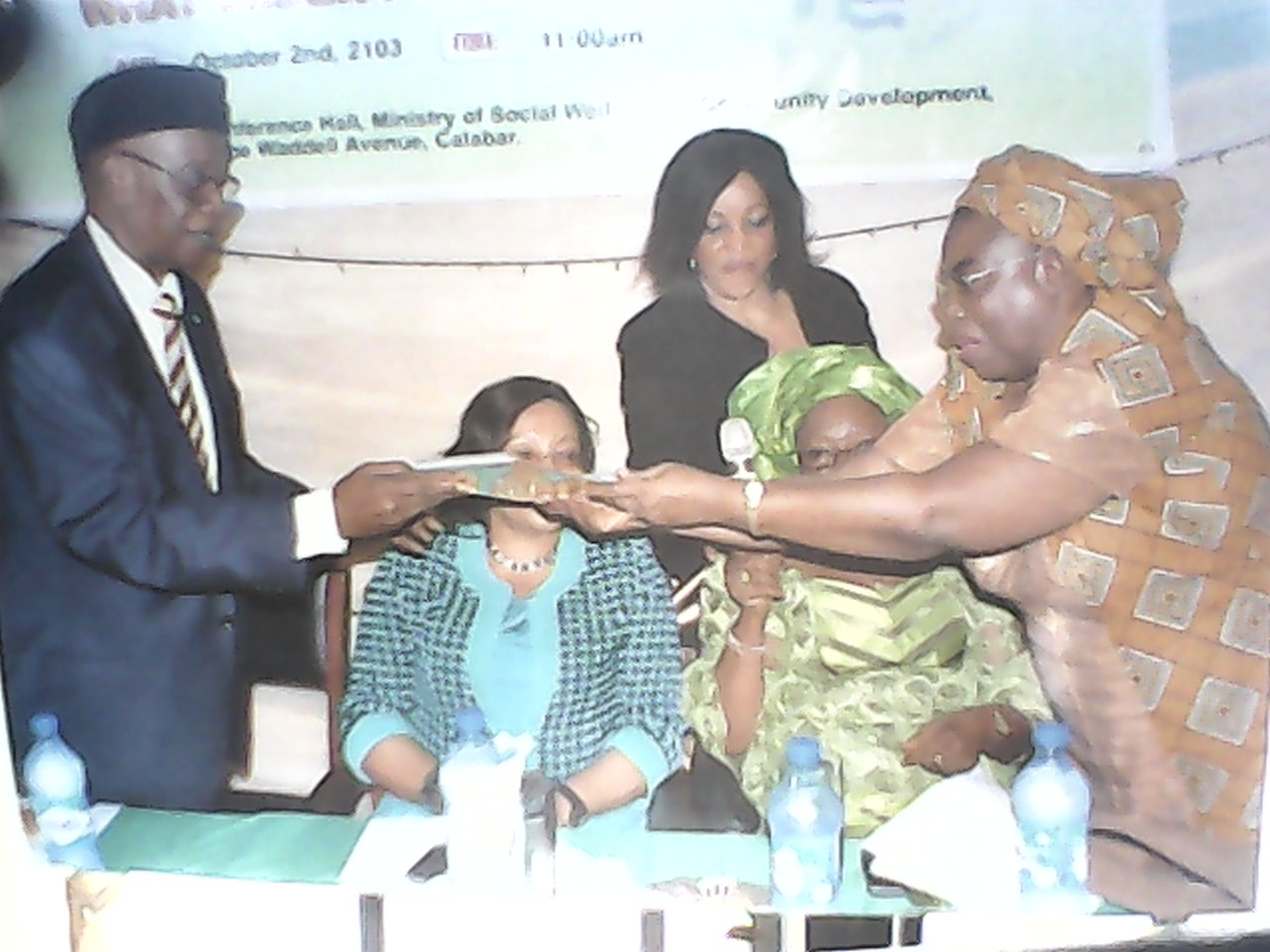 Permanent Secretary, Ministry of Social Welfare and Community Development giving the award to one of the recipients