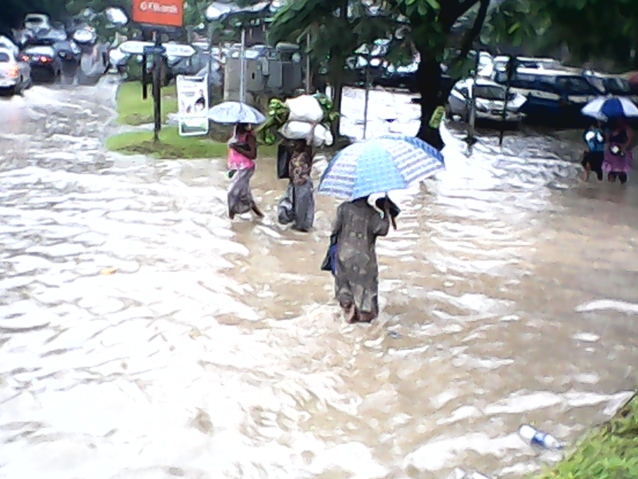 Pedestrians brazing the flood waters