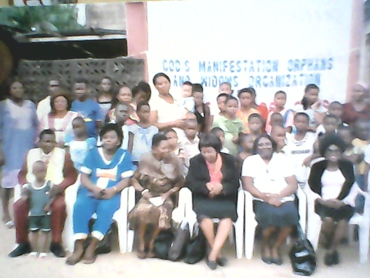 The orphans and ministry officials in a photo session
