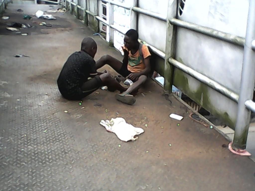 Street Children, Felix Ekeng and Joshua Daniel eating on the bridge