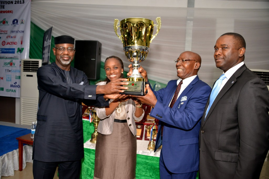 Cross River River Governor, Senator Liyel Imoke earlier receiving a trophy as the ICT Governor of the Year from the President/Chairman of Council, ISPON, Mr. Chris Uwaje(2nd left),assisted by the Honorable minister for ICT, Mrs. Omobola Johnson while Mr. Odo Effiong SA to Imoke on ICT devt watched during the 2013 Institute's National Software Conference & Competition at Tinapa, Calabar