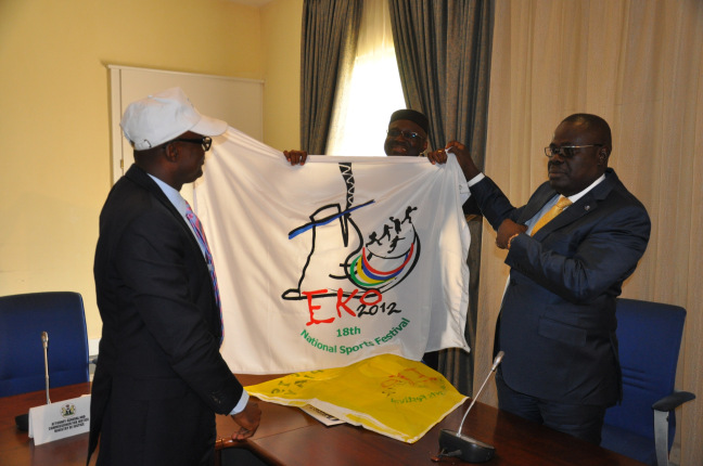 Cross River State Sports Commissioner, Patrick Ugbe (left) and the State Deputy Governor, Efiok Cobham with the flag of the 18th National Sports Festival which held in Lagos