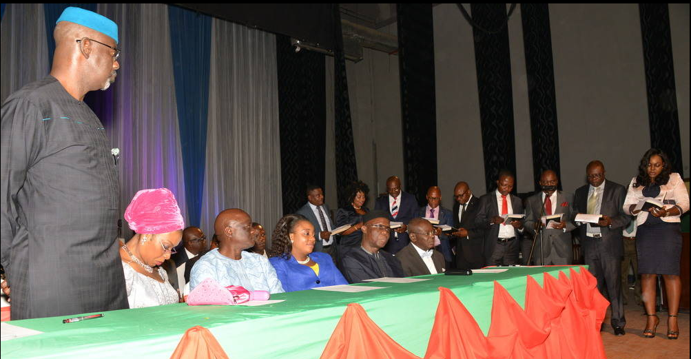 Cross River State Governor, Senator Liyel Imoke(left standing,) the wife Obioma, Speaker State House of Assembly, Hon. Larry Odey and wife, Eneyi Odey, state chairman of PDP, Ntufam John Okon and a rep of the state's chief judge watching the newly sworn-in local government chairmen taking oath of office in Calabar, today