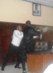 NACRISS impeached Senate President (Left) fighting the Acting President (Right)
