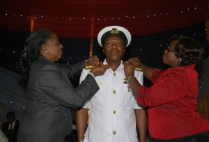Admiral P.A. Agba, FOC, Central Naval Command, CNC being decorated by the former Minister of State for Defence, Erelu Obada (left) and his wife, Mrs. Bimbo Agba (right) on his promotion to the rank of Rear Admiral