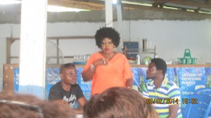 Member of AGNEC Cross River, Agnes Udoh speaking to members, while from L-R, Secretary of AGNEC, Ifiok Wisdom; Member, Mike Adem look on