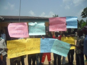 Cross section of Akansoko Youths bearing placards
