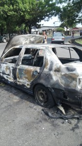 The bag snatchers Audi car that was set ablaze by the mob