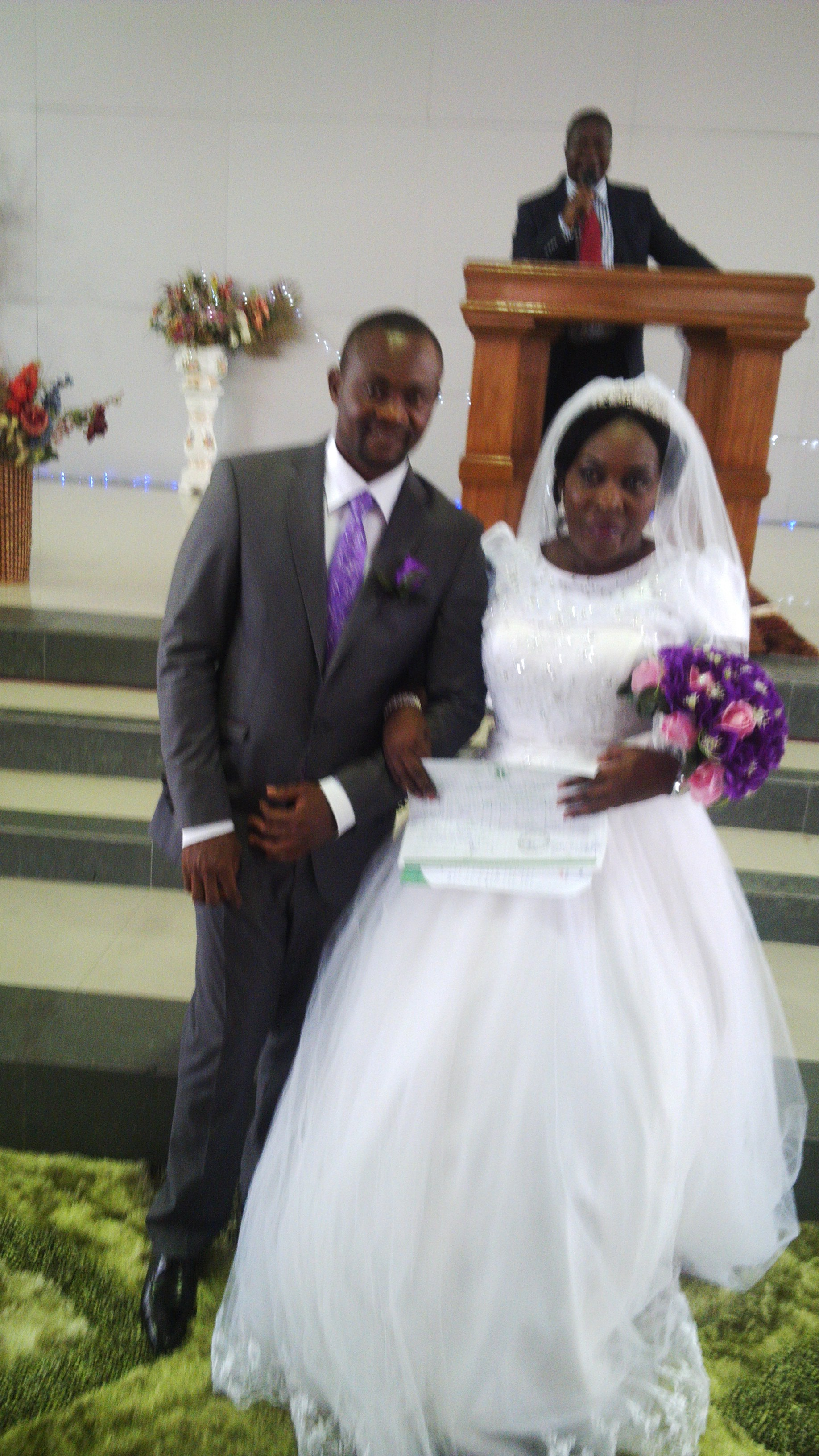 bassey ewa wedding 2 couple posing for photograph