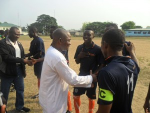 The Chairman LOC,  shaking the players of the Police and Fire Service team before kick-off of the opening match in Calabar