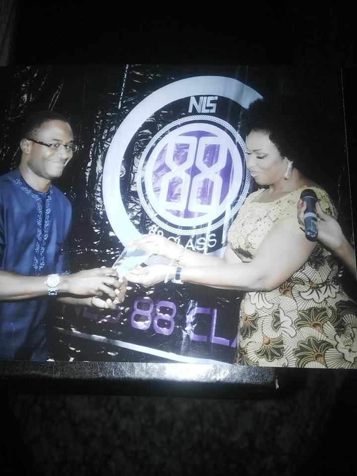 Barrister Venatius Ikem receiving his award from the Cross River First Lady, Mrs. Obioma Imoke