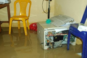 Photocopier in flood water at Unical