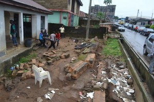 Collapsed Porthacourt Electricity Distribution Company (NEPA) office fence at Elijah Henshaw