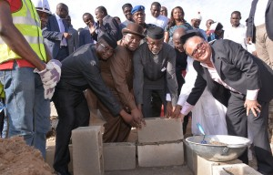 Cross River State Governor, Senator Liyel Imoke(m)assisted by Minister of Culture and Tourism, Chief Edem Duke, Arch Ladi Olatunde(L)and  MD Artee Group, Mr. Haresh Keswani  (R) during the foundation laying ceremony of  Calabar Shopping Mall, in Calabar