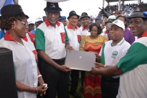 Cross River State Governor, Senator Liyel Imoke (2nd left) presenting the now controversial lap top computer to Mr. Francis Adie (2nd right), while the State NLC Chairman watches, during the May Day 2014 celebration in Calabar