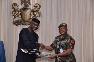 Senator Liyel Imoke presenting a souvenir to the Commander, Joint Task Force (JTF) on oil theft (Operation Pulo Shield) Maj. General Emmanuel J. Atewe, when he visited Government House, Calabar