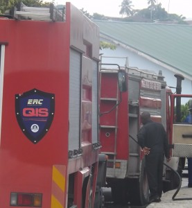 Men of the Cross River State Fire Service on hand to contain the fire. picture credit: calitown.com