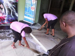 Staff of the resort sweeping water from the burnt theater picture credit: crossriverwatch.com