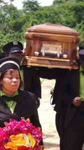 Pall bearers carrying late Mrs. Mbu's remains today