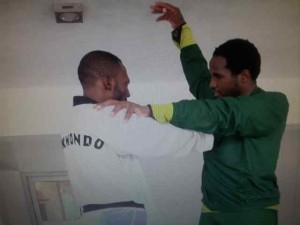Chika Chukwumerije (dressed in green) and a trainee